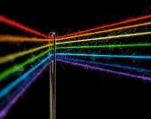 Multicolored Threads, Forming The Colors Of The Rainbow, Are Threaded Through The Eye Of A Sewing Ne poster