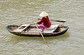 Vietnamese Woman Rowing