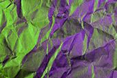 A Close Up Abstract Macro Photo Of Crumpled Creased Paper Lit With Green And Magenta Flash Gels poster