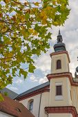 Litomysl, Czech Republic, Tower Od Church Of The Discovery Of The Holy Cross With Leaves In Autumn,  poster