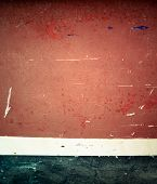 Scratched painted surface in two tones, red and black