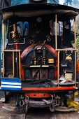 stock photo of darjeeling  - The driver and coal burner area in the rear of the toy train a major tourist attraction in Darjeeling India - JPG