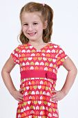 Young caucasian girl in a heart pattern dress