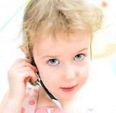 Little Girl With Hands-free Device. Child Helpline Concept