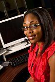 Beautiful African American receptionist or customer service representative