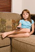 Young female child watching television