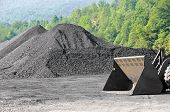 picture of nonrenewable  - A Large Stockpile of Coal with Endloader - JPG