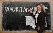 Teacher Showing Map Of Mauritania On Blackboard