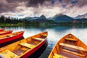 Mountain lake in National Park High Tatra. Dramatic overcast sky. Strbske pleso, Slovakia, Europe. B