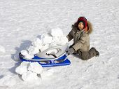 image of ruddy-faced  - Funny little boy with sledge outdoors in winter - JPG