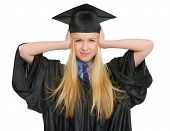 Frustrated Young Woman In Graduation Gown Closing Ears