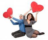 Couple Sitting Holding Hearts
