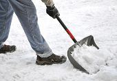 stock photo of shovel  - Man shoveling snow after a heavy snowfall - JPG