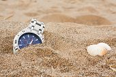 stock photo of discard  - wristwatch left discarded at the beach great for lost property or travel insurance - JPG