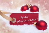 picture of weihnachten  - A Red Tag With the German Words Frohe Weihnachten Which Means Merry Christmas on it - JPG