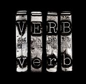 picture of verbs  - Verb concept in metal type on black background - JPG