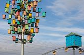 colorful birdhouses on a background of blue sky