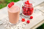 stock photo of chocolate spoon  - Chocolate and Fresh Raspberry Smoothie in a Glass - JPG