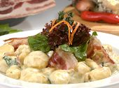 stock photo of carbonara  - Italian dumplings carbonara with bacon lettuce and cream sauce - JPG