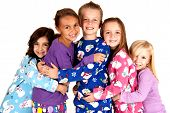 Happy Children In Winter Pajamas Hugging Each Other