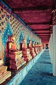 golden Buddha statues in Wat Arun temple, Bangkok