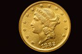 Twenty Liberty golden dollar coin. Isolated with path on black background