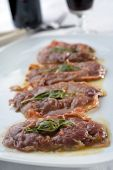Saltimbocca alla Romana on a rustic table