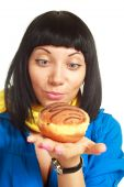Girl Eating A Roll With Chocolate