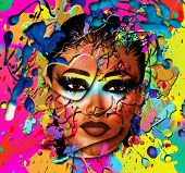 Close up face of a beautiful girl on an abstract background of splattered paint