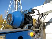Large Electric Motor Of Blue Color As The Drive To The  Fan