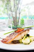 plum glazed grilled barramundi steak