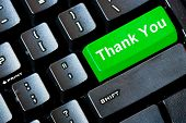 Green THANK YOU button on a computer keyboard