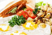 Fried Eggs With Sandwich And Vegetables