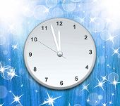 Clock on the wood texture showing 12 o'clock with bright light and many stars and bokeh. Christmas b