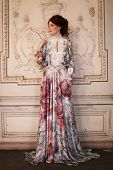 stock photo of manor  - young beautiful woman in pink dress posing in luxury palace - JPG
