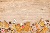 Homemade various christmas gingerbread cookies on wooden background