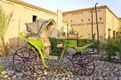 image of chariot  - Old carriage standing on a garden in the desert - JPG