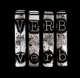 stock photo of verbs  - Verb concept in metal type on black background - JPG