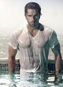 image of wet t-shirt  - Gorgeous male model in soaked wet t - JPG
