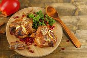 Roasted quails  on cutting board, on wooden table background