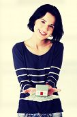 foto of zloty  - Happy woman holding polish zloty bills and house model  - JPG