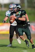 VIENNA,  AUSTRIA - JUNE 8 QB Jonathan Dally (#8 Dragons) runs with the ball during the AFL football