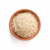 chinese blanched rice spilling out over a white background