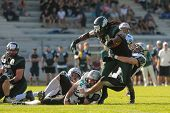 VIENNA,  AUSTRIA - JUNE 8 DB Markus Krause (#21 Raiders) tackles RB Tunde Ogun (#1 Dragons) during t