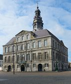 MAASTRICHT, NETHERLANDS - SEPTEMBER 8, 2013: Town hall on the Market square. The building was erecte