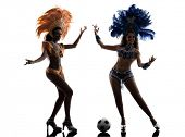 two women samba dancer playing soccer silhouette on white background