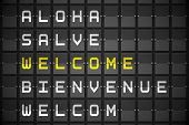 Welcome in languages on digitally generated black mechanical board