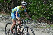 Female Cyclist On A Mountain Bike