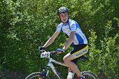 Happy Cyclist On A Mountain Bike