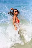 Woman Playing In Waves